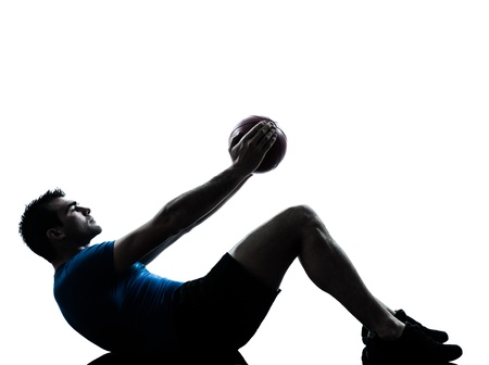 one caucasian man exercising workout holding fitness ball posture in silhouette studio  isolated on white background photo