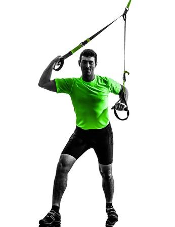 one caucasian man exercising   suspension training  trx   on white background photo
