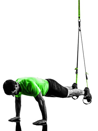 hang body: one caucasian man exercising   suspension training  trx   on white background