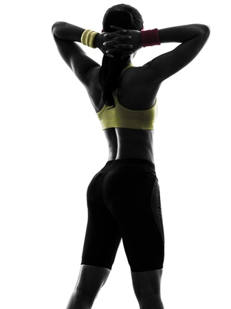 one  woman exercising fitness workout arms behind head  rear view in silhouette  on white background photo