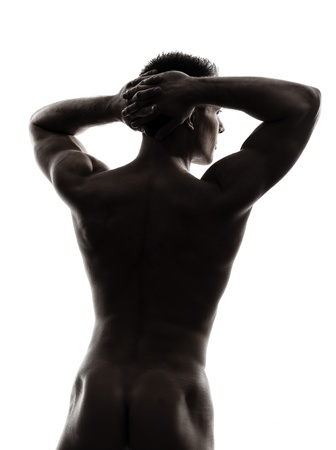 one caucasian handsome muscular man rear view back in silhouette studio on white background photo