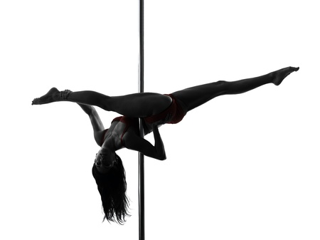 one caucasian woman pole dancer dancing in silhouette studio isolated on white background photo