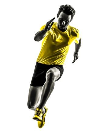 gente corriendo: un hombre cauc?sico joven sprinter running en estudio de la silueta sobre fondo blanco Foto de archivo