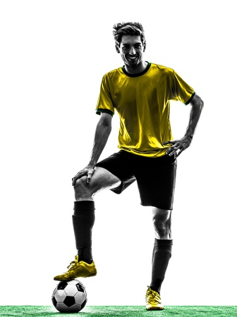 football player: one brazilian soccer football player young man standing in silhouette studio  on white background