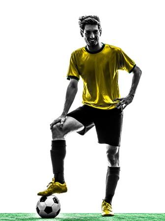 indoor soccer: una brasile?a de f?tbol jugador de f?tbol joven de pie en el estudio de la silueta sobre fondo blanco Foto de archivo