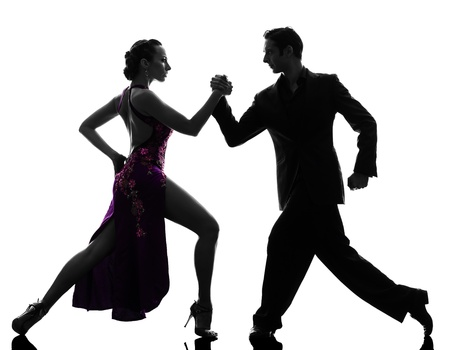 one caucasian couple man woman ballroom dancers tangoing  in silhouette studio isolated on white background photo