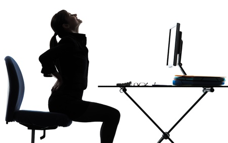 backache: one business woman sitting backache pain silhouette studio isolated on white background