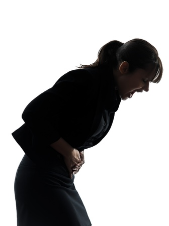 stomachache woman: one woman stomach pain cramp silhouette studio isolated on white background