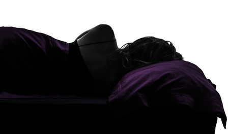one woman in bed sleeping lying on back silhouette studio on white background