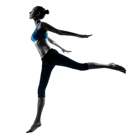 one caucasian woman exercising jumping stretching dancing in silhouette studio isolated on white background Imagens