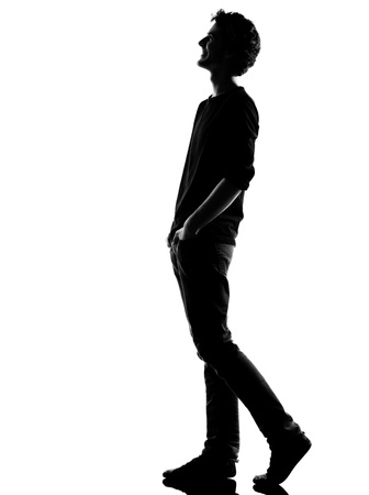 young man  walking  happy laughing silhouette in studio isolated on white background photo