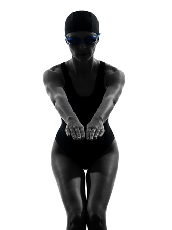 cut the competition: one caucasian woman competition swimmer on starting in silhouette studio isolated on white background Stock Photo