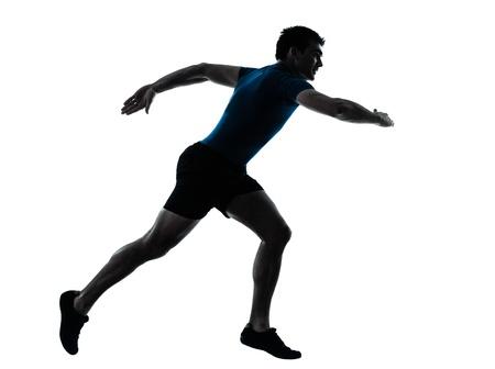 one caucasian man runner running sprinter sprinting  in silhouette studio  isolated on white background photo