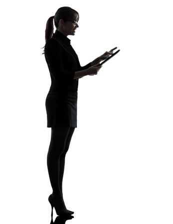 one business woman computer computing   silhouette studio isolated on white background Stock Photo