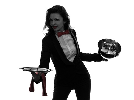 one caucasian woman waiter butler opening catering dome in silhouette  on white background photo