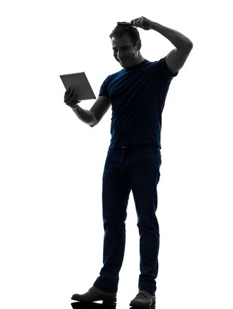 one caucasian man holding digital tablet  brushing hair  in silhouette on white background photo