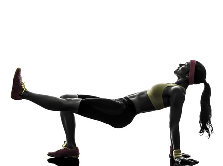 plank position: one  woman exercising fitness workout in silhouette  on white background