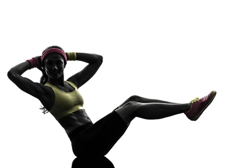 one  woman exercising crunches fitness workout arms behind head in silhouette  on white background