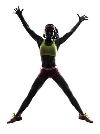 one caucasian woman jumping arms raised  in silhouette on white background Stock Photo - 21021880