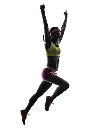 one caucasian woman runner running jumping  shouting in silhouette on white background photo