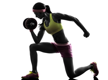 one caucasian woman exercising body builder weight training     in silhouette on white background photo