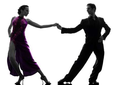 one caucasian couple man woman ballroom dancers tangoing  in silhouette studio isolated on white background Stock Photo