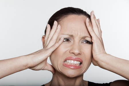 beautiful expressing woman portrait on siolated background confused headache hangover photo
