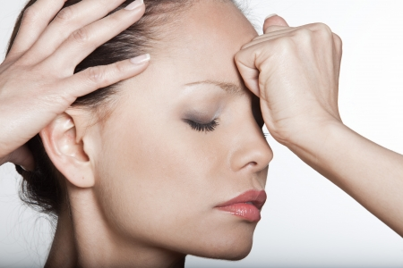 expressing negativity: beautiful expressing woman portrait on siolated background confused headache hangover Stock Photo