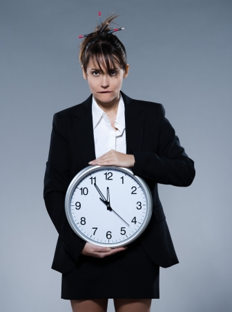 timekeeping: beautiful woman on isolated backgound holding a clock