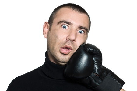 vanquish: studio shot portrait on isolated white background of a  Funny man hit by a boxing glove Stock Photo