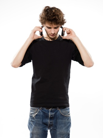 portable mp3 player: studio portrait of a caucasian young man listening to music on white background Stock Photo