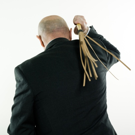 whipping: studio portrait isolated on white background of a man senior back whipping himself Stock Photo