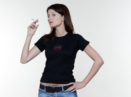 arrogant: studio portrait of a beautiful woman on isolated on white background smoking addiction concept