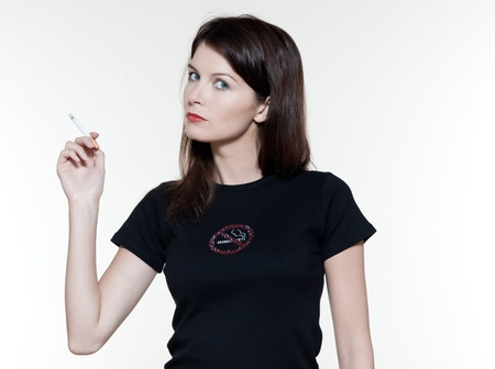 controversy: studio portrait of a beautiful woman on isolated on white background smoking addiction concept