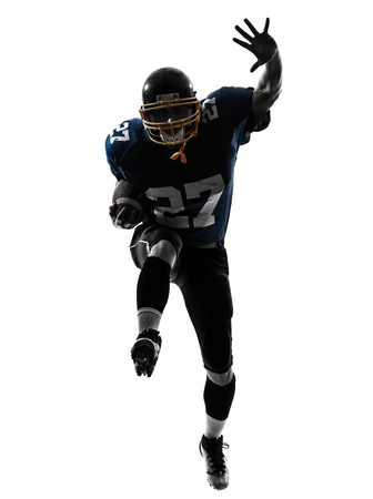 one caucasian american football player man running   in silhouette studio isolated on white background Stok Fotoğraf