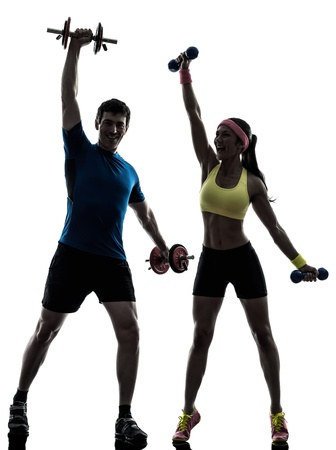 one  woman exercising fitness workout with man coach in silhouette  on white background