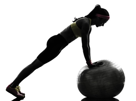 one  woman exercising fitness workout workout push ups  in silhouette  on white background photo