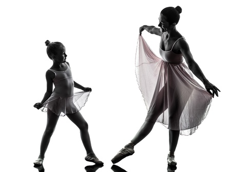 teaching and learning: woman and  little girl   ballerina ballet dancer dancing in silhouette on white background