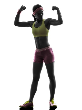 one caucasian woman exercising fitness flexing muscles   in silhouette on white background photo