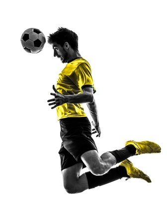 cut the competition: one brazilian soccer football player young man heading in silhouette studio  on white background