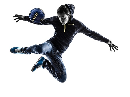 indoor soccer: one caucasian young man soccer freestyler player  in silhouette  on white background