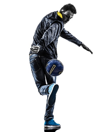 street shots: one caucasian young man soccer freestyler player  in silhouette  on white background