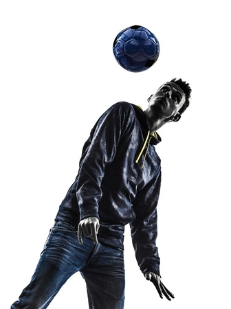 one caucasian young man soccer freestyler player  in silhouette  on white background photo
