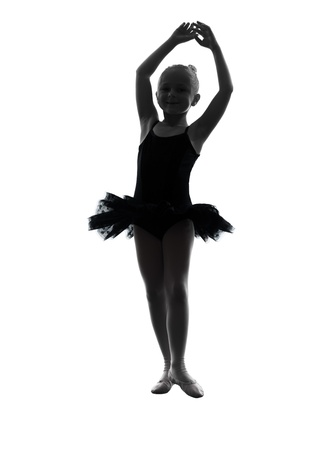 one  one little girl  ballerina ballet dancer dancing in silhouette on white background photo