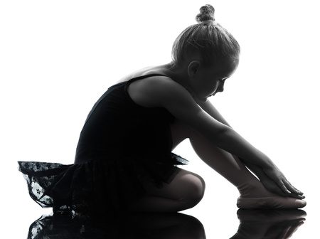 little: one  one little girl  ballerina ballet dancer dancing in silhouette on white background