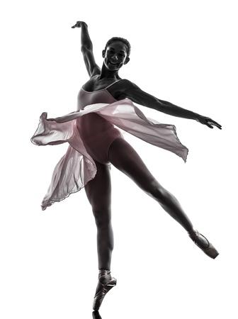 en pointe: one  woman   ballerina ballet dancer dancing in silhouette on white background