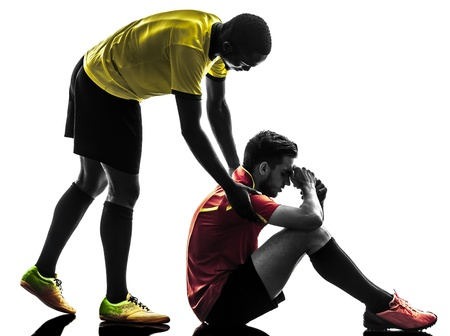 fairplay: two men soccer player playing football competition  fair play concept in silhouette  on white background