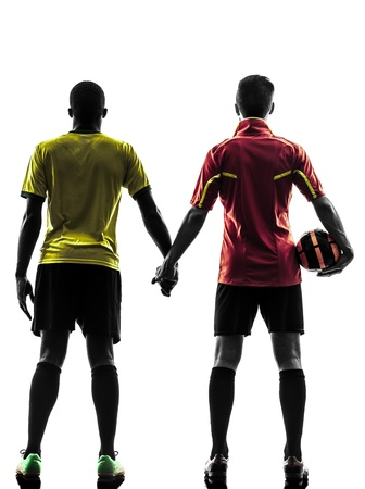 two men soccer player playing football competition hand in hand in silhouette  on white background photo