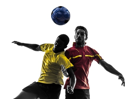 two men soccer player playing football competition fighting for a ball in silhouette on white background Banco de Imagens