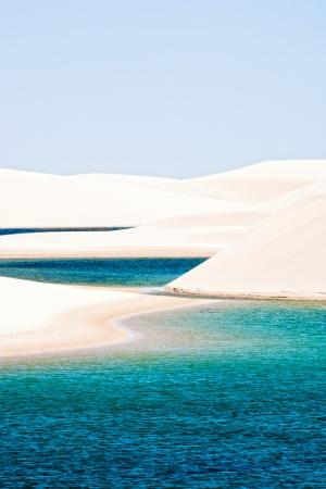 view of lagoa azul in desert white sand dunes of the Lencois Maranheses National Park in brazil photo